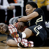 Kansas State forward Curtis Kelly, left, and Colorado guard Andre Roberson vie for a loose ball during the second half of an NCAA college basketball game in the Big 12 men's basketball tournament Thursday, March 10, 2011 in Kansas City, Mo. Colorado won 87-75. (AP Photo/Charlie Riedel)
