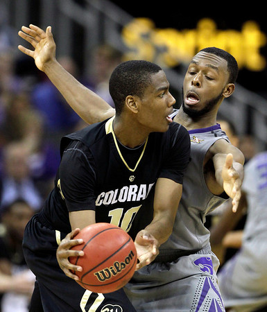 Kansas State guard Jacob Pullen, right, pressures Colorado guard Alec Burks (10) during the second half of an NCAA college basketball game in the Big 12 Men's Basketball tournament Thursday, March 10, 2011 in Kansas City, Mo. Colorado won the game 87-75. (AP Photo/Charlie Riedel)