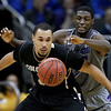 Kansas State forward Jamar Samuels, back, and Colorado forward Marcus Relphorde chase a loose ball during the second half of an NCAA college basketball game in the Big 12 men's tournament Thursday, March 10, 2011 in Kansas City, Mo. Colorado won  87-75. (AP Photo/Charlie Riedel)