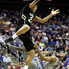 Colorado guard Andre Roberson (21) gets past Kansas State guard Jacob Pullen (0) to dunk the ball during the first half of an NCAA college basketball game in the Big 12 Men's Basketball tournament Thursday, March 10, 2011 in Kansas City, Mo. (AP Photo/Charlie Riedel)