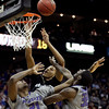 Colorado guard Andre Roberson, center, puts up a shot under pressure from Kansas State center Jordan Henriquez-Roberts (21) and forward Jamar Samuels (32) during the first half of an NCAA college basketball game at the Big 12 Conference tournament Thursday, March 10, 2011 in Kansas City, Mo. (AP Photo/Charlie Riedel)