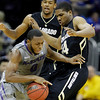 Kansas State guard Jacob Pullen (0) drives past Colorado guard Javon Coney (14) during the first half of an NCAA college basketball game at the Big 12 Conference tournament Thursday, March 10, 2011 in Kansas City, Mo. (AP Photo/Charlie Riedel)