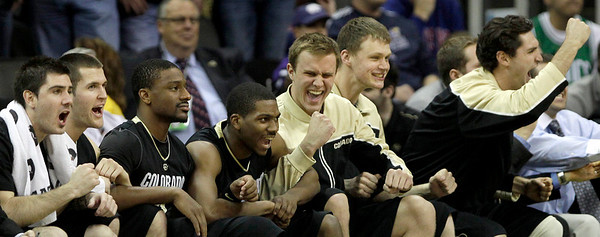 Colorado players celebrate a shot in the final moments of their NCAA college basketball game against Kansas State  in the Big 12 men's basketball tournament Thursday, March 10, 2011 in Kansas City, Mo. Colorado won the game 87-75. (AP Photo/Charlie Riedel)