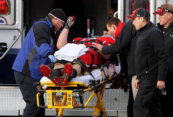 Utah offensive linesman Sam Brenner (74) raises his hand as he is loaded into an ambulance with a neck injury during the second half of an NCAA college football game against Colorado, Friday, Nov. 25, 2011, in Salt Lake City. Colorado won 17-14. (AP Photo/Jim Urquhart)