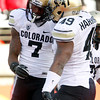 Colorado wide receiver Toney Clemons (7) celebrates with fullback Evan Harrington (49) after a reception by Clemons during the second half of an NCAA college football game against Utah, Friday, Nov. 25, 2011, in Salt Lake City. Colorado won 17-14. (AP Photo/Jim Urquhart)