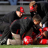 Utah running back John White IV (15) is attended to by trainers after being injured during the second half of an NCAA college football game against Colorado, Friday, Nov. 25, 2011, in Salt Lake City. Colorado won 17-14. (AP Photo/Jim Urquhart)