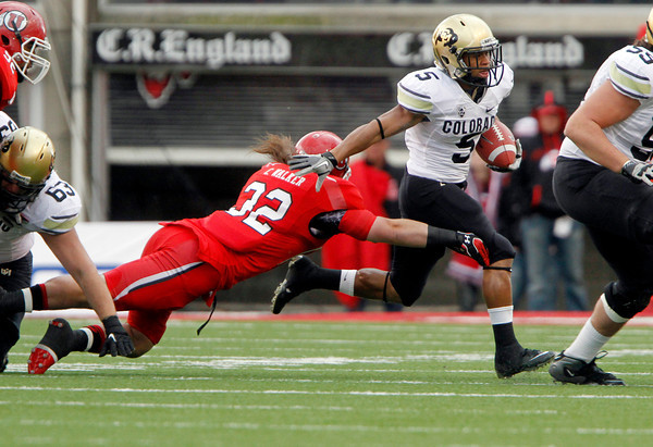 Utah linebacker Chaz Walker (32) is unable to tackle Colorado running back Rodney Stewart (5) during the first half of an NCAA college football game, Friday, Nov. 25, 2011, in Salt Lake City. (AP Photo/Jim Urquhart)