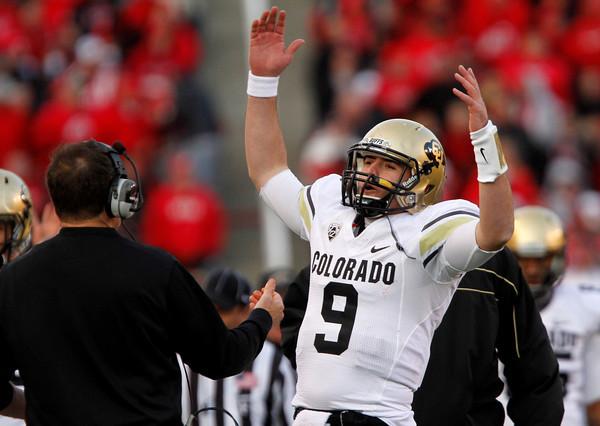 Colorado quarterback Tyler Hansen (9) celebrates after a play during the second half of an NCAA college football game against Utah, Friday, Nov. 25, 2011,in Salt Lake City. Colorado won 17-14. (AP Photo/Jim Urquhart)