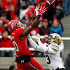 Utah wide receiver DeVonte Christopher (10) attempts a catch while defended by Colorado defensive back Parker Orms (13) during the first half of an NCAA college football game, Friday, Nov. 25, 2011, in Salt Lake City. (AP Photo/Jim Urquhart)