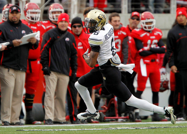Colorado wide receiver Paul Richardson (6) runs past the Utah sideline during the first half of an NCAA college football game, Friday, Nov. 25, 2011,in Salt Lake City. (AP Photo/Jim Urquhart)