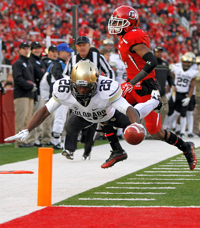 Colorado running back Tony Jones (26) dives for a touchdown past Utah defensive back Conroy Black (9) during the second half of an NCAA college football game, Friday, Nov. 25, 2011,in Salt Lake City. The play was called back for an offensive holding penalty. Colorado won 17-14. (AP Photo/Jim Urquhart)