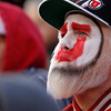A Utah fan watches during the second half of an NCAA college football game against Colorado, Friday, Nov. 25, 2011, in Salt Lake City. Colorado won 17-14. (AP Photo/Jim Urquhart)