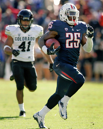 Arizona's Ka'Deem Carey (25) runs for a long gain against Colorado during the second half of an NCAA college football game at Arizona Stadium in Tucson, Ariz., Saturday, Nov. 10, 2012. Carey run for five touchdowns and 366 yards. Arizona won 56 - 31. (AP Photo/John Miller)