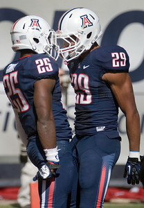 Arizona's Ka'Deem Carey (25) celebrates with teammate Austin Hill (29) during the first half of an NCAA college football game against Colorado at Arizona Stadium in Tucson, Ariz., Saturday, Nov. 10, 2012. Arizona won 56-31. (AP Photo/Wily Low)