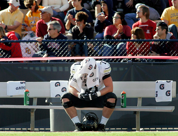 Colorado's Alexander Lewis (71) reacts on the bench during the fourth quarter in an NCAA college football game against Arizona at Arizona Stadium in Tucson, Ariz., Saturday, Nov. 10, 2012. Arizona won 56 - 31. (AP Photo/John Miller)