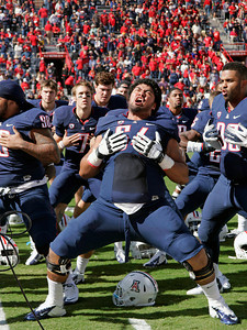 Arizona's Faitele Faafoi (64) and his teammates perform the Samoa war dance called the Haka on the sidelines before the start an NCAA college football game against Colorado at Arizona Stadium in Tucson, Ariz., Saturday, Nov. 10, 2012. Arizona won 56 - 31. (AP Photo/John Miller)