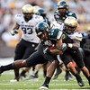 Hawaii's Jeremiah Ostrowski gets tackled by Colorado linebacker Douglas Rippy during the third quarter of an NCAA college football game against Colorado, Saturday, Sept. 3, 2011, in Honolulu.  (AP Photo/Marco Garcia)