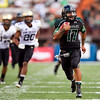 Hawaii quarterback Bryant Moniz runs 57 yards for a second quarter touchdown during the the NCAA college football game against Colorado, Saturday, Sept. 3, 2011, in Honolulu.  (AP Photo/Marco Garcia)