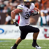 Colorado tight end Ryan Deehan gains yardage during the second quarter of an NCAA college football game against Hawaii, Saturday, Sept. 3, 2011, in Honolulu.  (AP Photo/Marco Garcia)