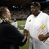 Colorado head coach Jon Embree, right, shakes hands with Hawaii head coach Greg McMackin at the end of the fourth quarter of an NCAA college football game, Saturday, Sept. 3, 2011, in Honolulu. Hawaii defeated Colorado 34-17.  (AP Photo/Marco Garcia)
