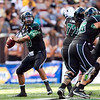 Hawaii quarterback Bryant Moniz makes a pass during the first quarter of an NCAA college football game against Colorado, Saturday, Sept. 3, 2011, in Honolulu.  (AP Photo/Marco Garcia)