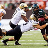 Hawaii wide receiver Billy Ray Stutzmann, right, runs into the Colorado defensive players Greg Henderson, left, Anthony Perkins, and Travis Sandersfeld during the third quarter of their NCAA college football game against Hawaii, Saturday, Sept. 3, 2011, in Honolulu.  (AP Photo/Marco Garcia)