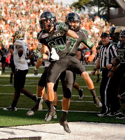 Hawaii's Jeremiah Ostrowski, left, and quarterback Bryant Moniz celebrate after Moniz ran in a 57 yard touchdown during the second quarter of the the NCAA college football game against Colorado, Saturday, Sept. 3, 2011, in Honolulu. (AP Photo/Marco Garcia)