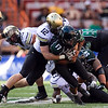 Colorado linebacker Patrick Mahnke sacks Hawaii quarterback Bryant Moniz during the first quarter of an NCAA college football game, Saturday, Sept. 3, 2011, in Honolulu. (AP Photo/Marco Garcia)