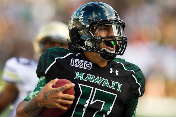 Hawaii quarterback Bryant Moniz reacts after running 57 yards for a second-quarter touchdown during an NCAA college football game against Colorado, Saturday, Sept. 3, 2011, in Honolulu.  (AP Photo/Marco Garcia)