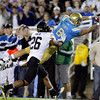 UCLA tight end Joseph Fauria (8) dives into the end zone for a touchdown against Colorado defensive back Ray Polk during the first half of an NCAA college football game at the Rose Bowl in Pasadena, Calif., Saturday, Nov. 19, 2011. (AP Photo/Jae Hong)