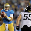 UCLA quarterback Kevin Prince, left, looks to pass against Colorado linebacker David Goldberg during the first half of an NCAA college football game at the Rose Bowl in Pasadena, Calif., Saturday, Nov. 19, 2011. (AP Photo/Jae Hong)