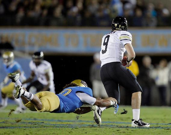UCLA linebacker Eric Kendricks, left, sacks Colorado quarterback Tyler Hansen during the first half of an NCAA college football game at the Rose Bowl in Pasadena, Calif., Saturday, Nov. 19, 2011. (AP Photo/Jae Hong)