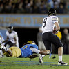 UCLA linebacker Eric Kendricks, left, sacks Colorado quarterback Tyler Hansen during the first half of an NCAA college football game at the Rose Bowl in Pasadena, Calif., Saturday, Nov. 19, 2011. (AP Photo/Jae Hong)