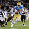 UCLA wide receiver Nelson Rosario, center, carries the ball for a touchdown against Colorado's Greg Henderson, left, and Jon Major during the second half of an NCAA college football game at the Rose Bowl in Pasadena, Calif., Saturday, Nov. 19, 2011. UCLA won 45-6. (AP Photo/Jae Hong)