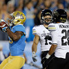 UCLA running back Johnathan Franklin, left, celebrates his touchdown as Colorado's Jason Espinoza and Greg Henderson, right, look on during the first half of an NCAA college football game at the Rose Bowl in Pasadena, Calif., Saturday, Nov. 19, 2011. (AP Photo/Jae Hong)