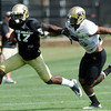 """Wide Receiver Toney Clemons, 17, tries to fend off Defensive Back Ray Polk, 26, during the University of Colorado football practice on Wednesday morning<br /> Photo by Paul Aiken  August 10, 2011.<br /> <br /> FOR MORE PHOTOS AND VIDEO INTERVIEWS FROM PRACTICE GO TO  <a href=""""http://WWW.DAILYCAMERA.COM"""">http://WWW.DAILYCAMERA.COM</a> AND BUFFZONE. COM"""