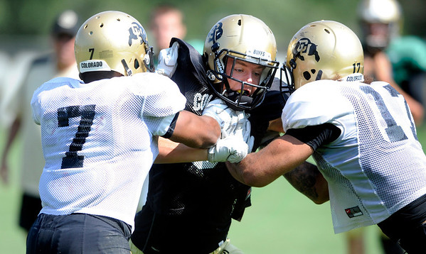 at the University of Colorado football practice on Wednesday morning<br /> Photo by Paul Aiken  August 10, 2011.