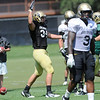 Ryan Deehan, 34 waits for Quarterback Tyler Hansen to celebrate his touchdown at the University of Colorado football practice on Wednesday morning<br /> Photo by Paul Aiken  August 10, 2011.