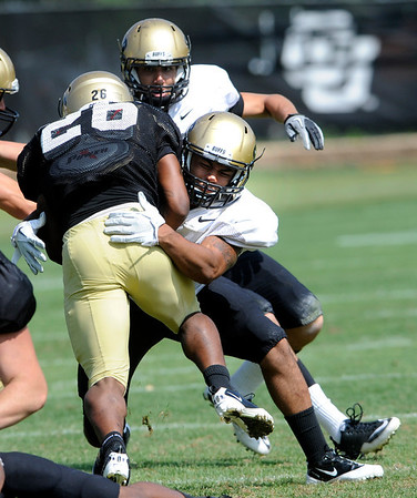 "Terrel Smith, 41, puts a hit on Tailback Tony Jones, 26, during the University of Colorado football practice on Wednesday morning<br /> Photo by Paul Aiken  August 10, 2011.<br /> <br /> FOR MORE PHOTOS AND VIDEO INTERVIEWS FROM PRACTICE GO TO  <a href=""http://WWW.DAILYCAMERA.COM"">http://WWW.DAILYCAMERA.COM</a> AND BUFFZONE. COM"