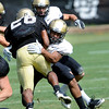 """Terrel Smith, 41, puts a hit on Tailback Tony Jones, 26, during the University of Colorado football practice on Wednesday morning<br /> Photo by Paul Aiken  August 10, 2011.<br /> <br /> FOR MORE PHOTOS AND VIDEO INTERVIEWS FROM PRACTICE GO TO  <a href=""""http://WWW.DAILYCAMERA.COM"""">http://WWW.DAILYCAMERA.COM</a> AND BUFFZONE. COM"""