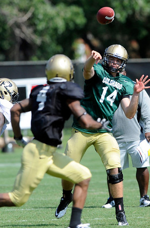 John Schrock, 14, completes a pass to Kennan Canty, 4 at the University of Colorado football practice on Wednesday morning<br /> Photo by Paul Aiken  August 10, 2011.