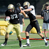 "Tight End Alex Wood, 84 fends off Defensive Back Will Harlos, 28, during the University of Colorado football practice on Wednesday morning<br /> Photo by Paul Aiken  August 10, 2011. FOR MORE PHOTOS AND VIDEO INTERVIEWS FROM PRACTICE GO TO  <a href=""http://WWW.DAILYCAMERA.COM"">http://WWW.DAILYCAMERA.COM</a> AND BUFFZONE. COM"