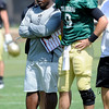 Coach Eric Bieniemy talks with Quarterback Tyler Hansen at the University of Colorado football practice on Wednesday morning<br /> Photo by Paul Aiken  August 10, 2011.