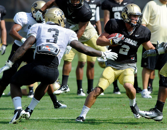 "Wide Receiver Logan Gray, 2, moves around Linebacker Douglas Rippy during the University of Colorado football practice on Wednesday morning<br /> Photo by Paul Aiken  August 10, 2011.<br /> FOR MORE PHOTOS AND VIDEO INTERVIEWS FROM PRACTICE GO TO  <a href=""http://WWW.DAILYCAMERA.COM"">http://WWW.DAILYCAMERA.COM</a> AND BUFFZONE. COM"