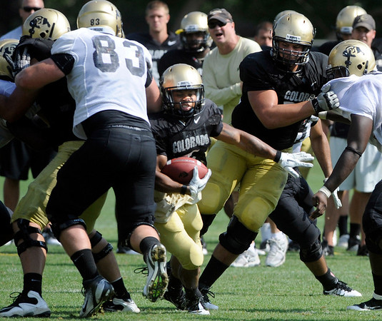 "Tailback Rodney Stewart, 5, moves through the line during the University of Colorado football practice on Wednesday morning<br /> Photo by Paul Aiken  August 10, 2011.<br /> FOR MORE PHOTOS AND VIDEO INTERVIEWS FROM PRACTICE GO TO  <a href=""http://WWW.DAILYCAMERA.COM"">http://WWW.DAILYCAMERA.COM</a> AND BUFFZONE. COM"