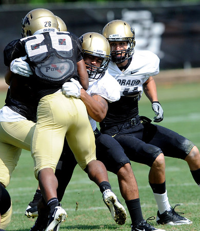 "Terrel Smith, 41, puts a hit on Tailback Tony Jones, 26, during the University of Colorado football practice on Wednesday morning<br /> Photo by Paul Aiken  August 10, 2011.<br /> FOR MORE PHOTOS AND VIDEO INTERVIEWS FROM PRACTICE GO TO  <a href=""http://WWW.DAILYCAMERA.COM"">http://WWW.DAILYCAMERA.COM</a> AND BUFFZONE. COM"