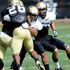 """Terrel Smith, 41, puts a hit on Tailback Tony Jones, 26, during the University of Colorado football practice on Wednesday morning<br /> Photo by Paul Aiken  August 10, 2011.<br /> FOR MORE PHOTOS AND VIDEO INTERVIEWS FROM PRACTICE GO TO  <a href=""""http://WWW.DAILYCAMERA.COM"""">http://WWW.DAILYCAMERA.COM</a> AND BUFFZONE. COM"""