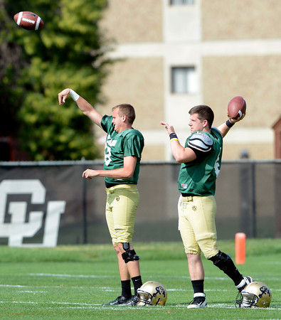 """Quarterbacks Stevie Joe Dorman, 918) at left, and Jordan Webb (4) make practice throws during the University of Colorado football team practice on Monday August 20, 2012. <br /> For more photos go to  <a href=""""http://www.buffzone.com"""">http://www.buffzone.com</a><br /> Photo by Paul Aiken / The Boulder Camera"""