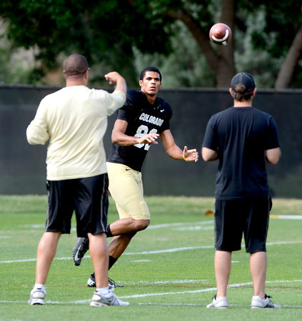 "Jarrod Darden (82) tracks down a pass during the University of Colorado football team practice on Monday August 20, 2012. <br /> For more photos go to  <a href=""http://www.buffzone.com"">http://www.buffzone.com</a><br /> Photo by Paul Aiken / The Boulder Camera"