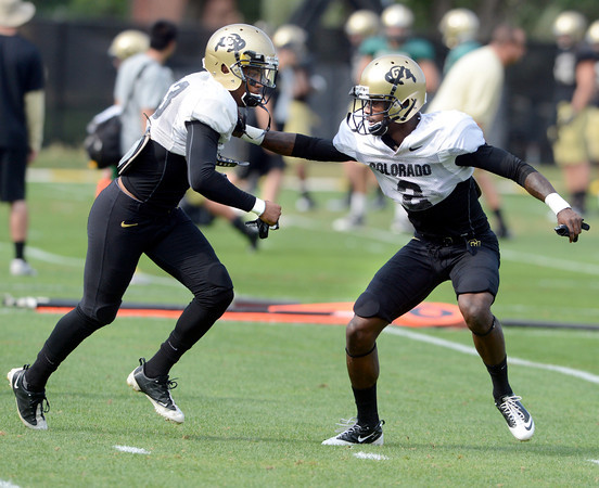 """Sherrard Henderson (23))at left, and Kenneth Crawley (2) work on a pass coverage drill during the University of Colorado football team practice on Monday August 20, 2012. <br /> For more photos go to  <a href=""""http://www.buffzone.com"""">http://www.buffzone.com</a><br /> Photo by Paul Aiken / The Boulder Camera"""